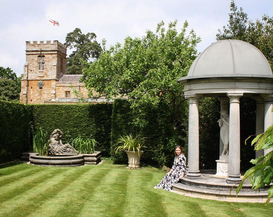 katy smith poses in the haddonstone show gardens