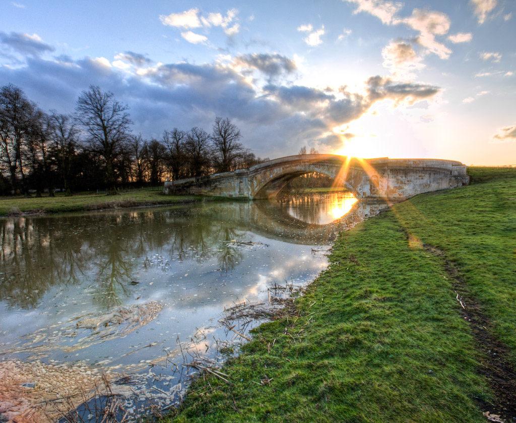 A bridge photographed at dawn at Tyringham Hall