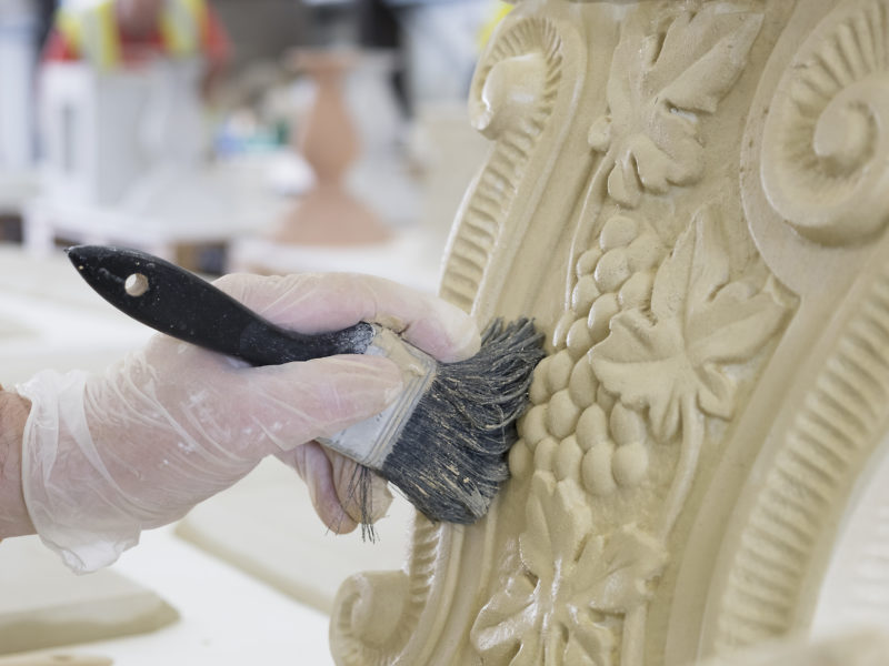 A Haddonstone colleague cleans a cast stone design in the factory.