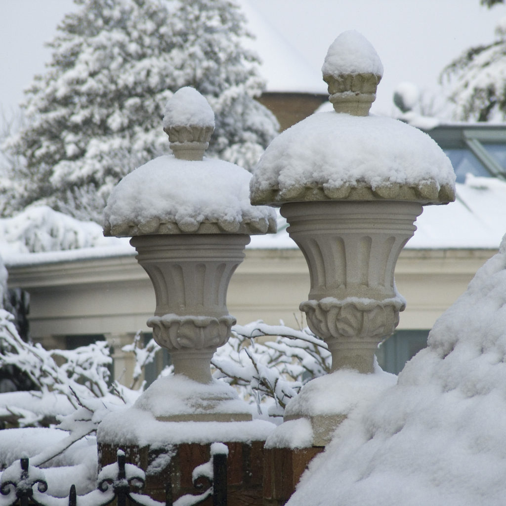 Haddonstone decorative finials photographed in the snow