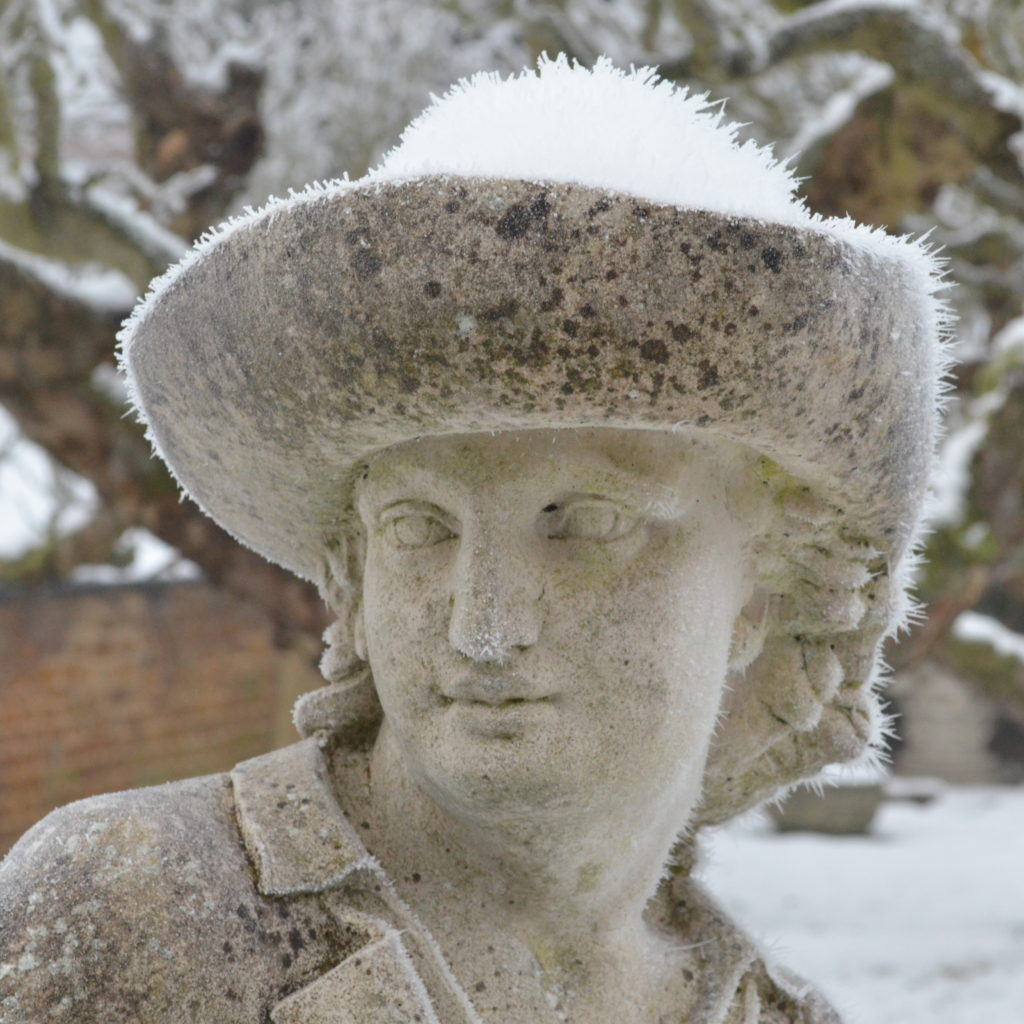 The Haddonstone The Gardener Statue photographed in the snow