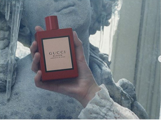 Gucci perfume photographed infront of the Haddonstone Bacchante bust