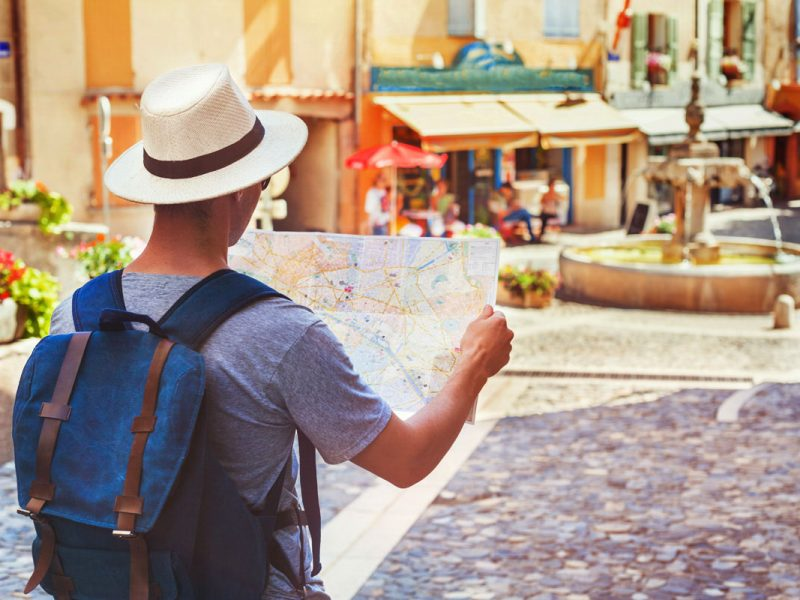 photo of a tourist looking at a map