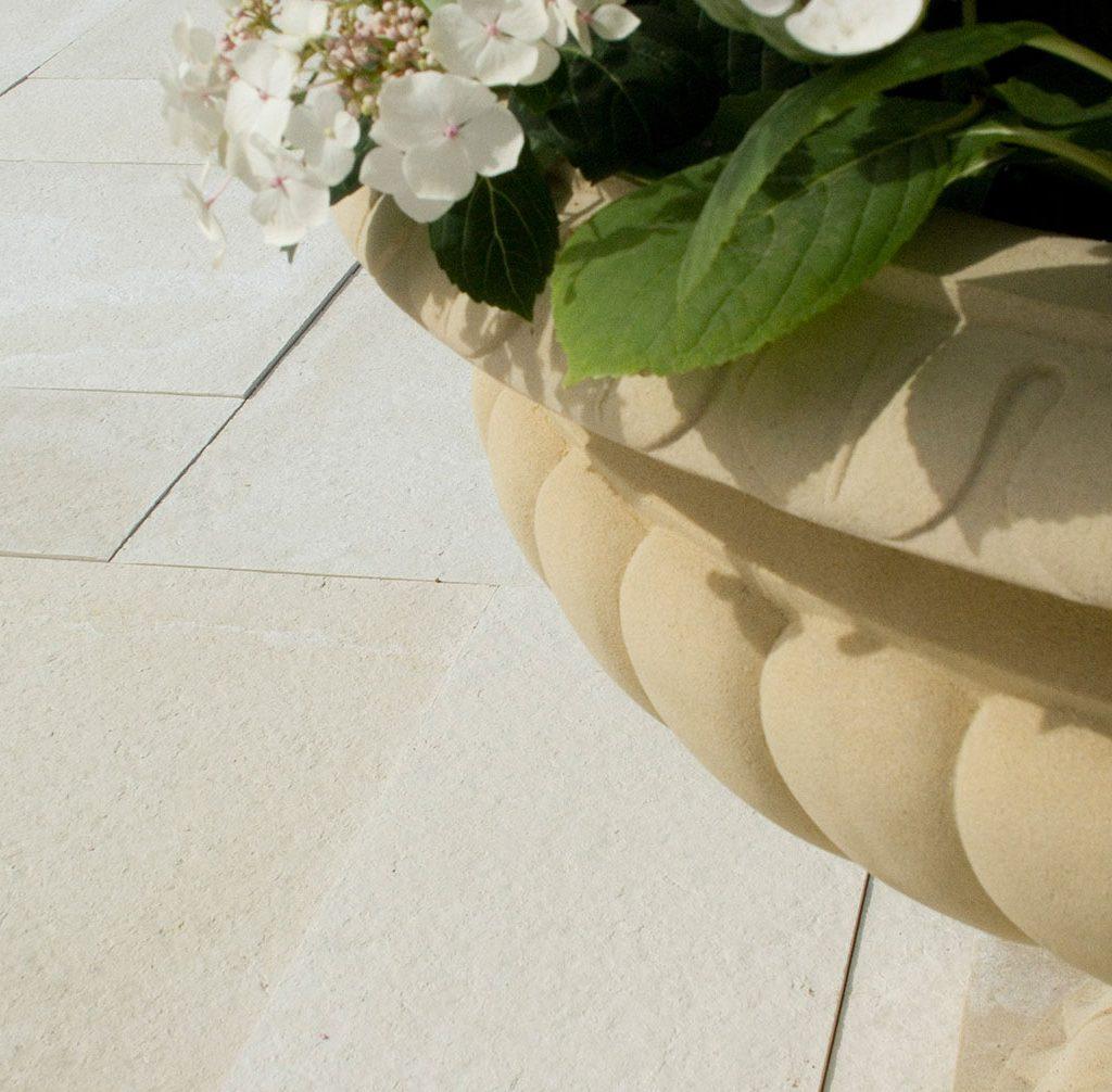 cast stone paving stones - textured in creme