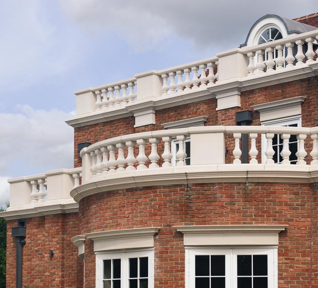 cast stone balustrades and window heads by haddonstone in white