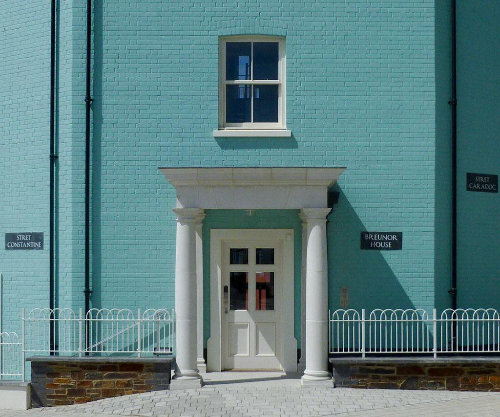haddonstone cast stone white portico on green building