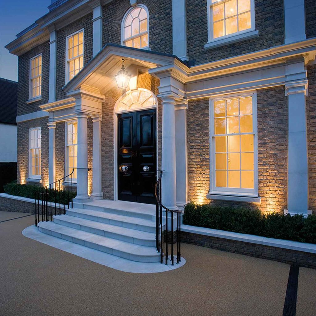 cast stone porticos from haddonstone white at night