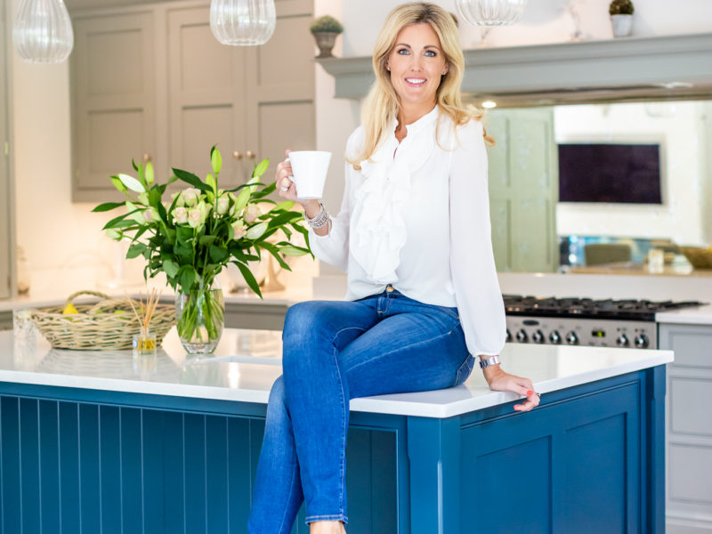 Profile picture of Rebecca Doyle sitting in her kitchen