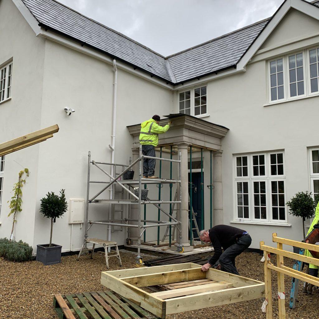 Rebecca's installers work on her Haddonstone portico